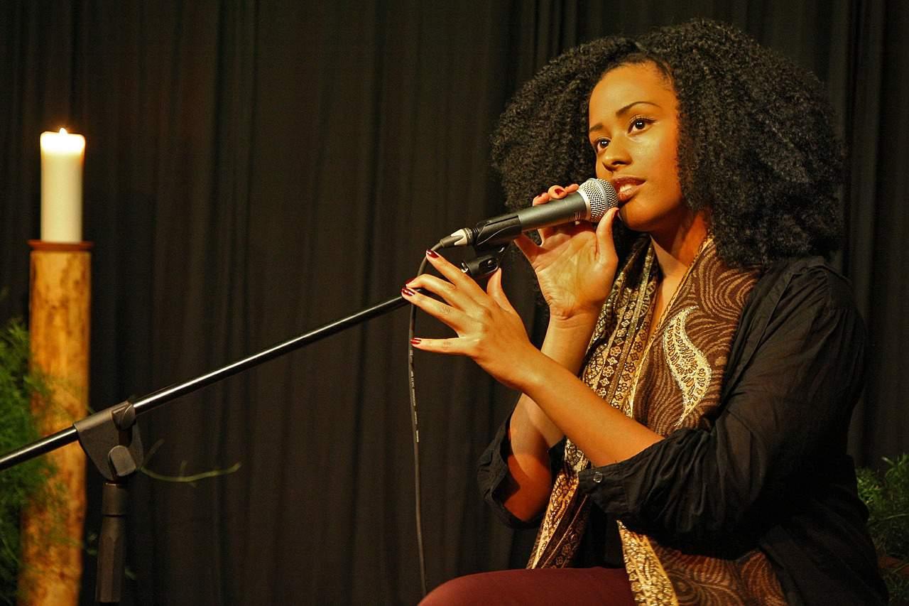 girl singing into mic