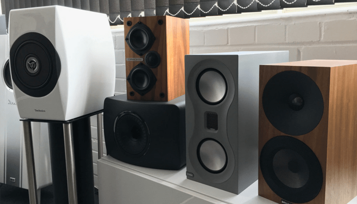 range of bookshelf speakers lined up on white table