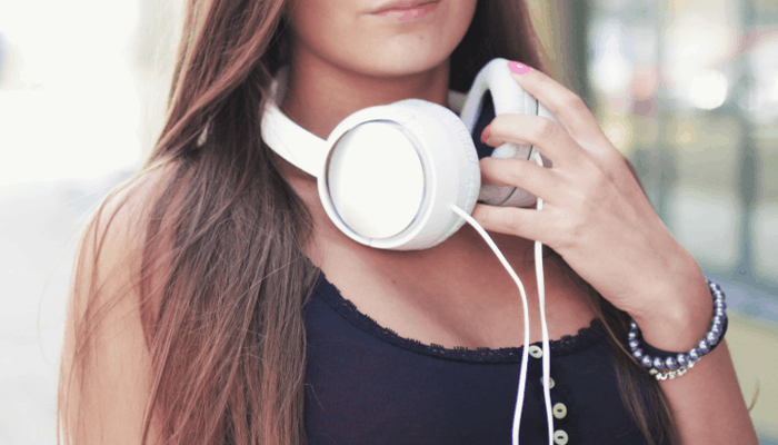 Woman with white headphone