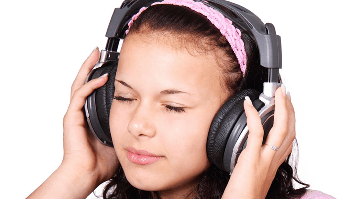 Girl with headphone listening to music