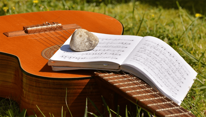 Books on top of acoustic guitar