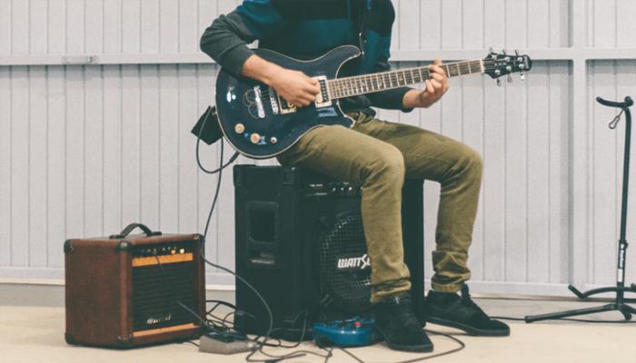 Man sitting on the Amp