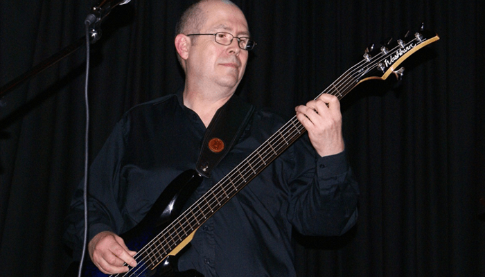 Man playing 5 string bass guitar
