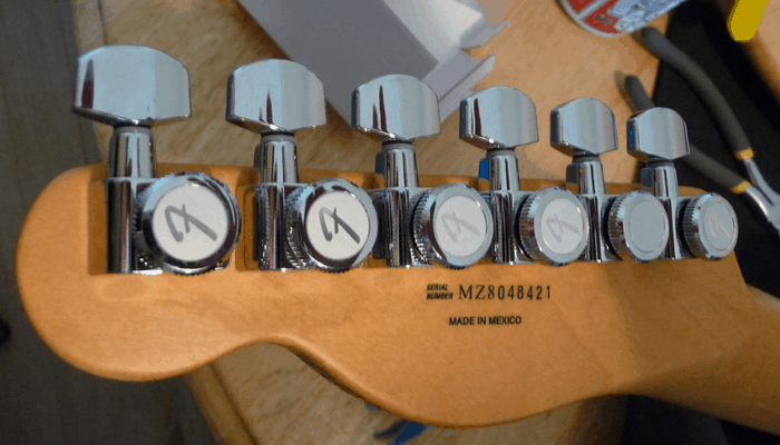 Guitar head with locking tuners