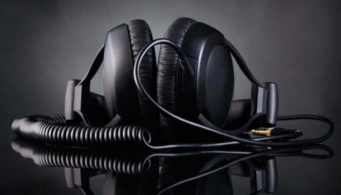 Modern headphones over dark background
