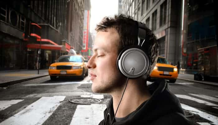Man closed eyes while listening to his Headphone