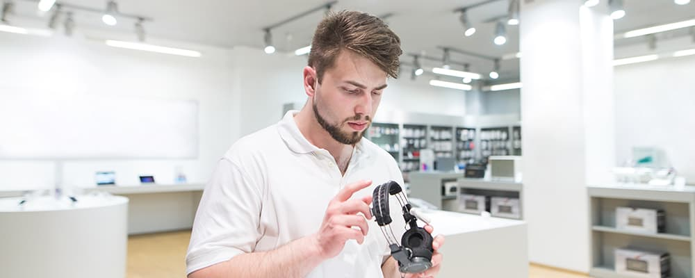 Man checking headphone