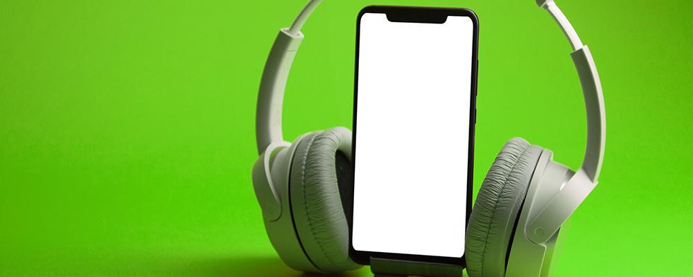 White headphones on smartphone