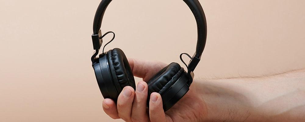 Wireless headphones in man hand