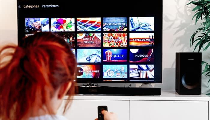 Redhead woman watching tv